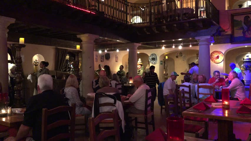 Families eating and socializing at mexican-style restaurant CABO SAN LUCAS MEXICO 2017   Shutterstock HD Video #24446207
