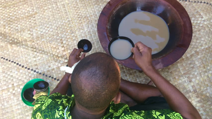 Fijian man drinks Kava drink in Fiji. Kava is a mildly narcotic drink made from mixing the powdered root of the pepper plant with water and results in a numb feeling and a sense of relaxation
