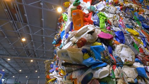 Plastic bottles ready for recycling. Garbage sorting plant. Dolly shot.