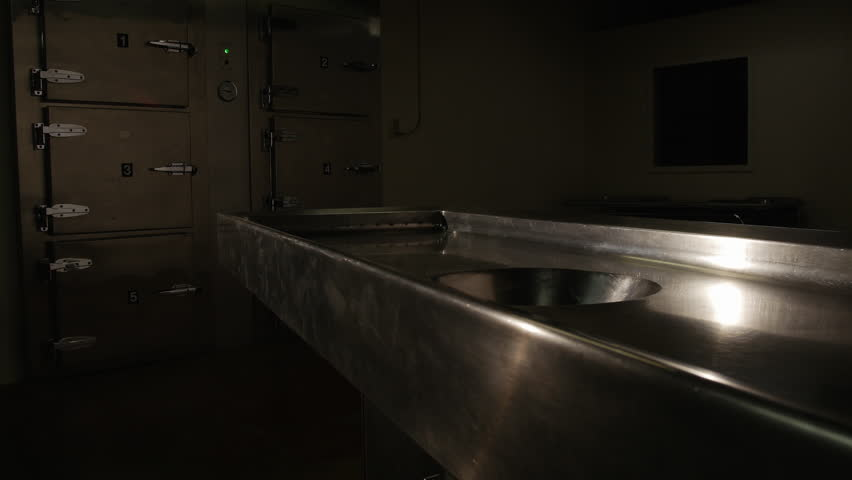 COLD, EMPTY MORGUE AWAITS A NEW CUSTOMER.  NUMBER ONE IN A SERIES OF FOUR VARIATIONS.  SLOW DOLLY ACROSS AUTOPSY TABLE TO NEGATIVE SPACE.  COLD STORAGE IN THE BACKGROUND.  SHOT IN 4K, 10 BIT, 4:2:2. | Shutterstock HD Video #24493301