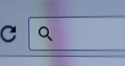 Video footage of a cursor typing http on the browser bar. Internet Search Concept