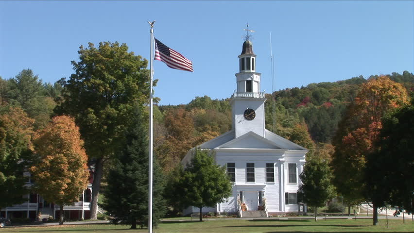 Wide shot of a Church and flagpole in Vermont United States | Shutterstock HD Video #2451167