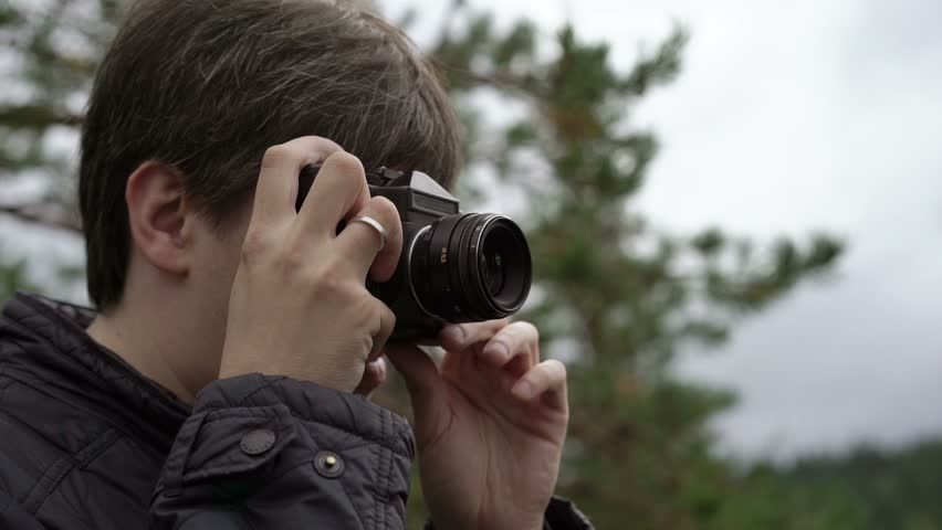 Boy Photographer Is Taking Some Still With His Dslr Camera And ...