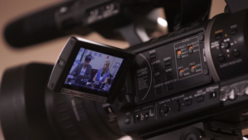 Videorecording at lecture on professional camera | Shutterstock HD Video #24573887