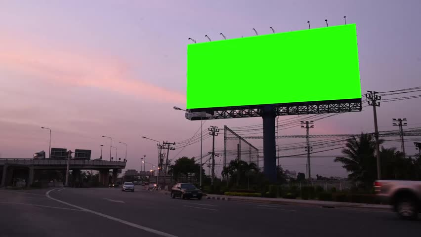 Advertising billboard on sidelines of road with day to night time lapse | Shutterstock HD Video #24584909