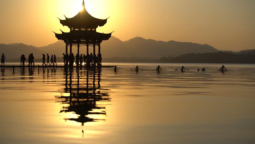 Chinese ancient pavilion in beautiful sunset,at Hangzhou city,China