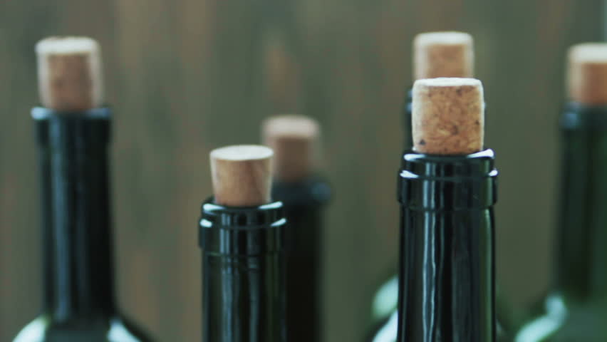 Wine bottles with the corks | Shutterstock HD Video #24605597
