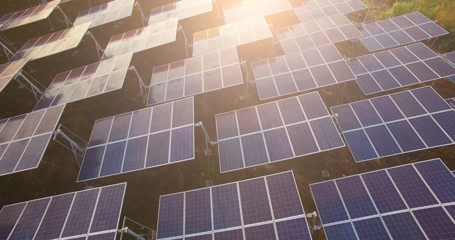 4K Aerial view of Solar Panels Farm (solar cell) with sunlight.Drone flight fly over solar panels field renewable green alternative energy concept in Thailand. | Shutterstock HD Video #24610817