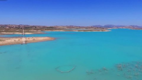 Video from the air, flying on a drone above the blue lake in Spain
