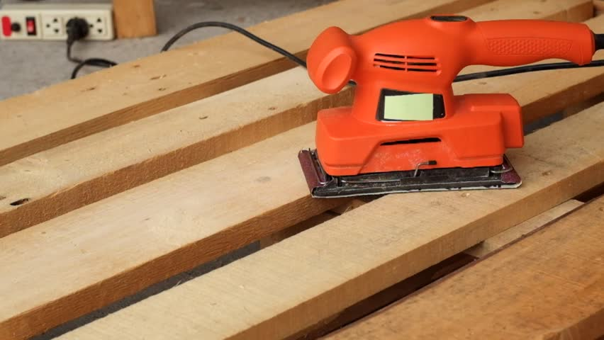 Wood sanding machines , Carpenter working with electrical sander on pine floor or table surface | Shutterstock HD Video #24645167