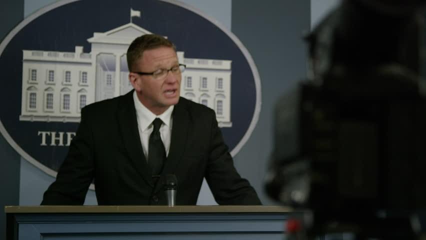 Press Secretary - Rack focus from podium to camera - white house