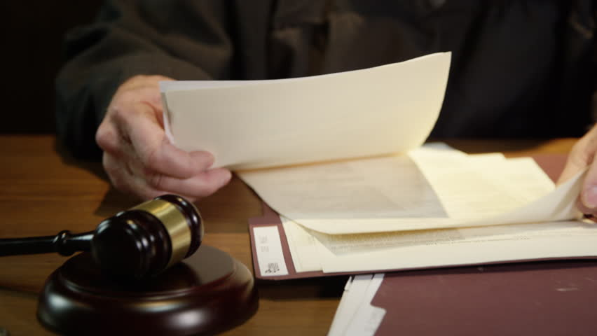 Judge going over documents in court