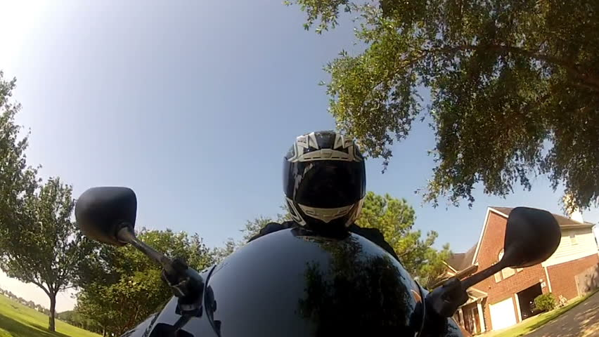 View from a camera attached to the front fender of the motorcycle up to the motorcyclist. GoPro camera
