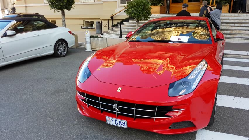 Monte-Carlo, Monaco - March 8, 2017: Beautiful Red Ferrari FF Parked in Front of the Monte-Carlo Casino in Monaco in The French Riviera