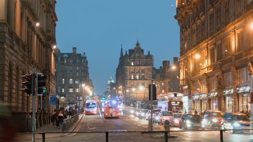 EDINBURGH, SCOTLAND - JAN 24: (Timelapse)  City nightlife on Princes Street downtown Edinburgh, Scotland on January 24, 2017. Princes St is the busiest road in Edinburgh and its main shopping center.