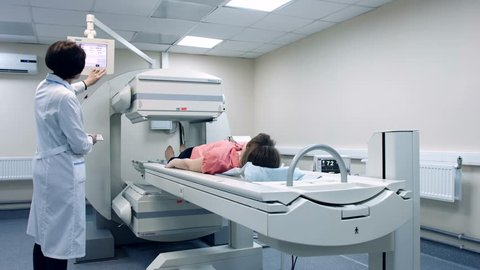 A hospital patient is scanned by the latest medical technology. CT scanner. Radiology equipment.