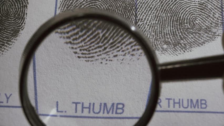 Fingerprints are investigated on fingerprint card. Macro shot.
