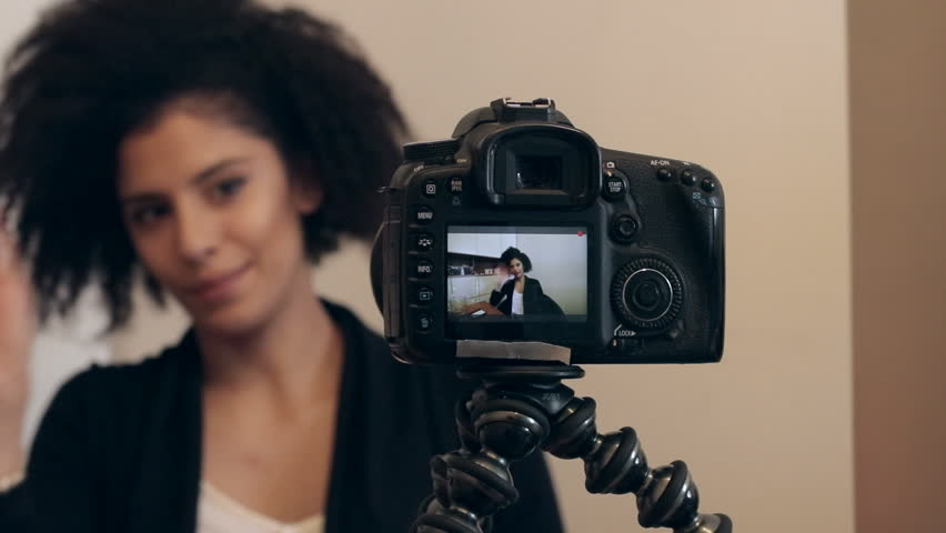 Influencer shooting video blog or vlog