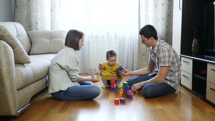 Baby girl playing blocks with her parents. Family concept. Full Hd Slow Motion Stock Footage. | Shutterstock HD Video #24767987