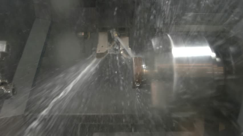 Lathe in action closeup. Splashes of water. Cnc machine coolant. | Shutterstock HD Video #24778307