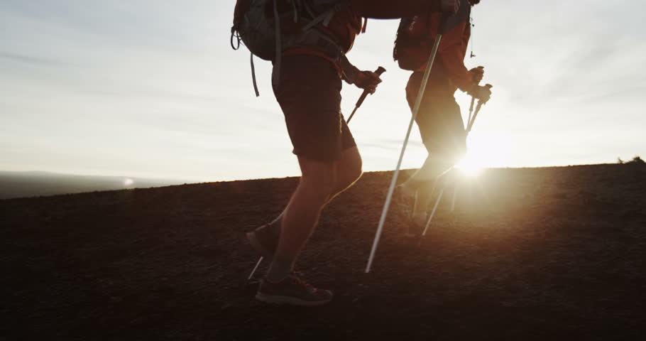 Two men hiking in silhouette past rising sun slow motion | Shutterstock HD Video #24789767