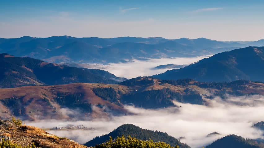 Fantastic foggy valley glowing by sunlight. Picturesque morning scene. Location place Carpathian, Ukraine, Europe. Beauty world. Time lapse clip, interval shooting video. | Shutterstock HD Video #24791387