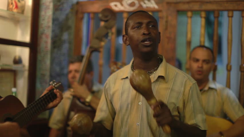 the cuban band eco caribe filmed performing in the bodaguita del medio bar in havana. all band members are model released.