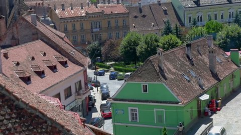 View from the lock on a historical part of the city of Sighisoara, houses are roofed by a red tile