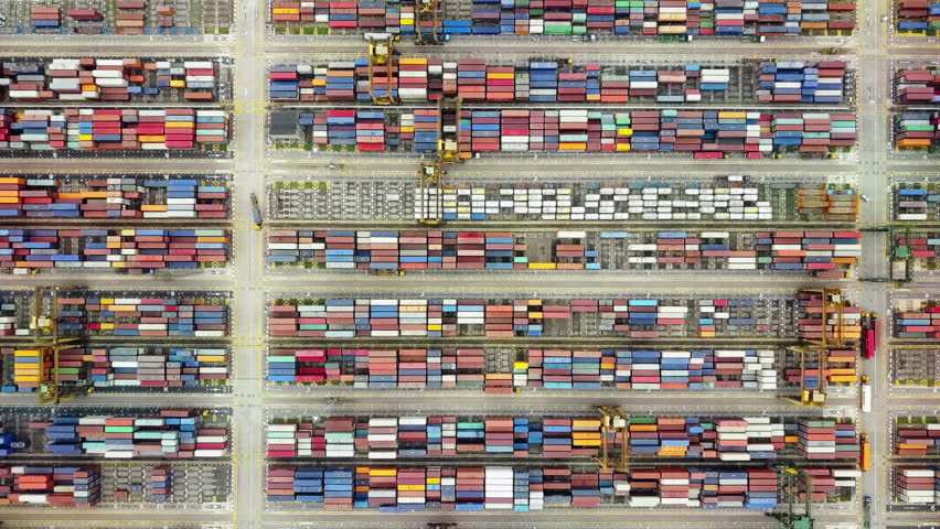 Aerial footage of busy container park revealing shipping port harbour, global logistics international trade concept