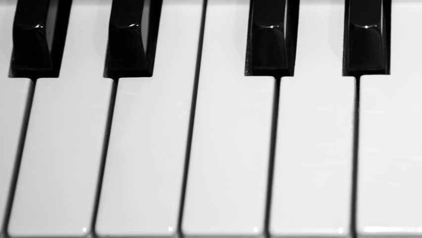 how many black and white keys does a piano have