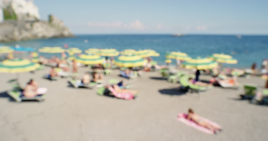 People On Beach In Europe Sunbathing Enjoying Summer Vacation Woman Wearing Bikini Swimming Sun Tanning