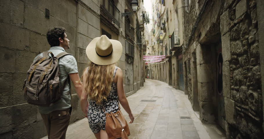 Rear view tourist woman Walking narrow streets of Barcelona Wearing cute summer dress enjoying European summer holiday travel vacation adventure | Shutterstock HD Video #24944507