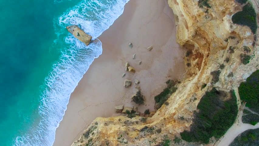 4K Drone Aerial teal colored water, beautiful rock formations of Marinha Beach, Praia da Marinha, Algarve Portugal, camera looking straight down | Shutterstock HD Video #24957197