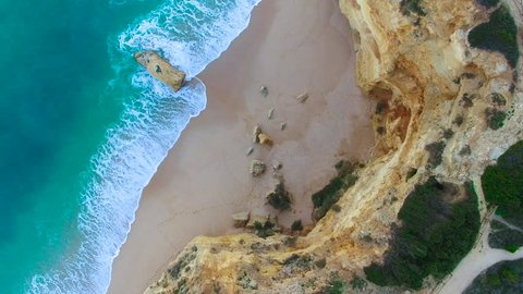 4K Drone Aerial teal colored water, beautiful rock formations of Marinha Beach, Praia da Marinha, Algarve Portugal, camera looking straight down