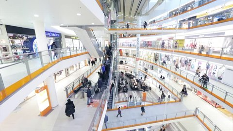 Russia, Saint-Petersburg, 16 March 2017: Interiors trade and the business center the Nevsky center, Starbucks Cafe in the bottom of an atrium, clothing stores, grocery shops, elevators, escalators