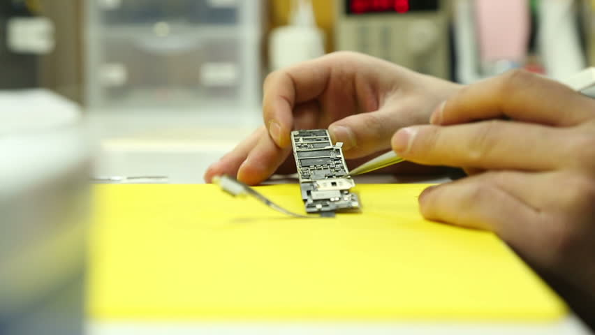 Visual inspection and Troubleshooting electronic circuit Board mobile | Shutterstock HD Video #24975767