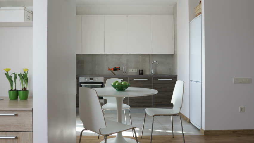 4K. Interior of modern apartment in scandinavian style with kitchen and workplace. Motion panoramic view.