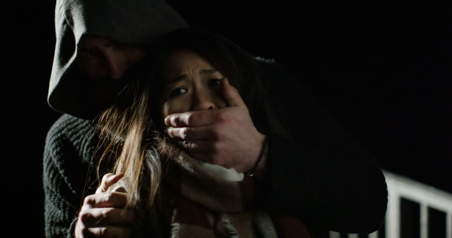 4k, A terrified young woman is taken hostage by a sinister man. Slow motion | Shutterstock HD Video #25028594