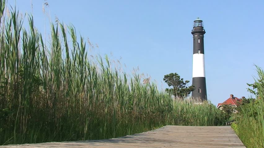 Light House with Boardwalk and Green Grasses