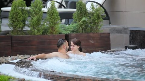 Couple relaxing in the jacuzzi.