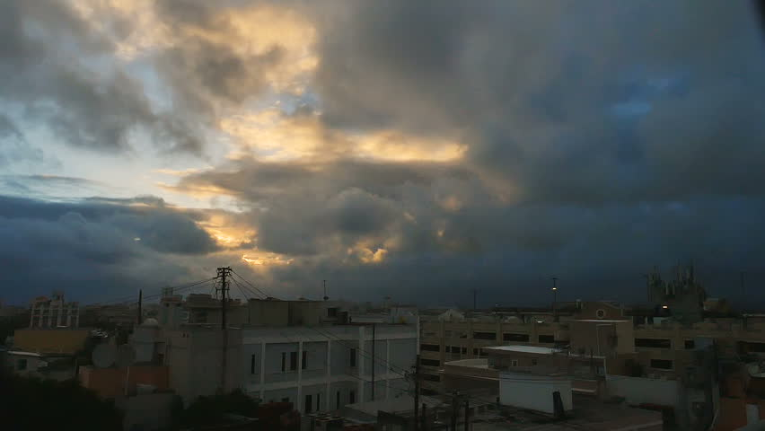 Darkness over roof tops old town San Juan, Puerto Rico as first light of day highlights the rapidly blowing clouds   Shutterstock HD Video #25062107