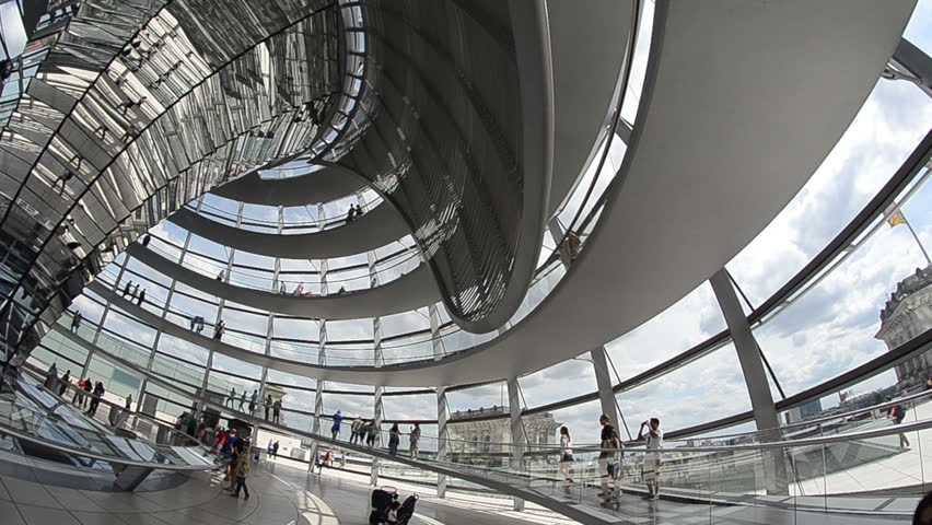 BERLIN - JUNE 10: People move inside the Cupola of the Reichstag building on June 10, 2012 in Berlin, Germany.