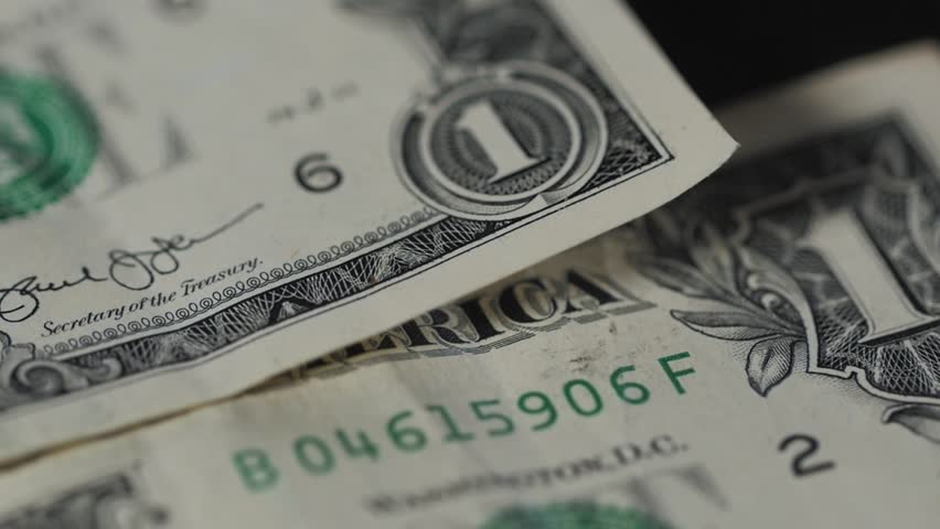 Close up image of a united states dollar isolated on black background | Shutterstock HD Video #25138247