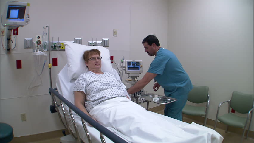 Emergency department staff evaluate a female patient.