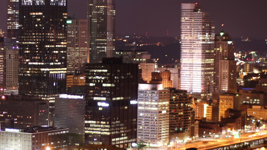 Dramatic nighttime time lapse shot of Pittsburgh, PA.  As seen from Mount Washington.  Corporate logos digitally obfuscated for general usage.  | Shutterstock HD Video #2526407