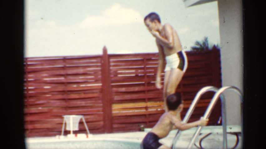MINNESOTA 1963: the boy swimming pool the swimming very fast near the wall and steps steel small boy morning time | Shutterstock HD Video #25264187