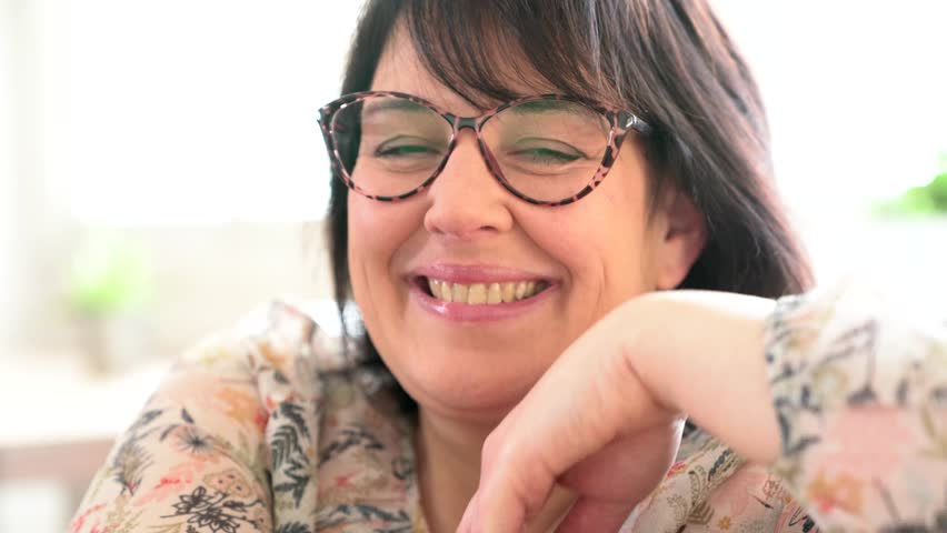 Portrait of cheerful mature woman with eyeglasses