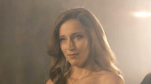 Beautiful opera singer girl. 4k Portrait close up of the artist singer.
