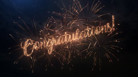 Congratulations greeting text with particles and sparks on black night sky with colored slow motion fireworks on background, beautiful typography magic design.