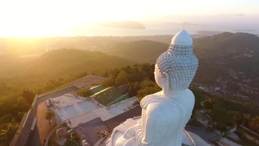 Beautiful Golden Sunrise at White Big Buddha Statue Temple. HD Aerial View. Phuket, Thailand.
